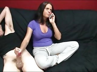 Giving a handjob while talking on the phone