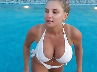 Busty Nastya. Girl with huge tits out of the pool.