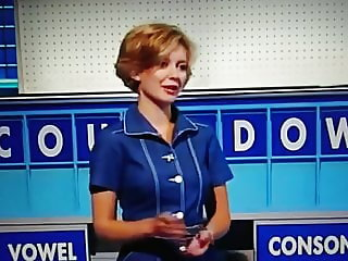 Sexy Quiz host in show stockings top