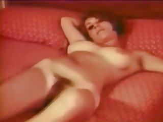 Vintage tease, lascivious Candy Earle on her bed
