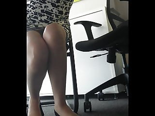 Office undertable candid legs