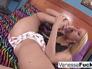 Cute Vanessa cleans, oils up and plays with her feet