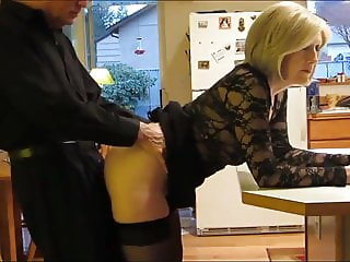 mature milf in stockings with her neighbor in kitchen