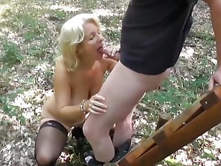 naughty mature wife loves her neighbor in the woods