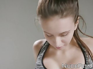 Busty young beauty working out while topless