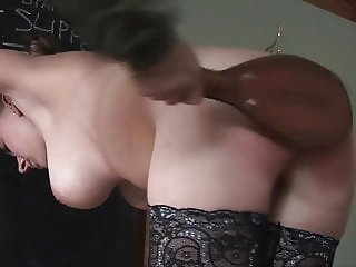 Belinda Lawson gets spanked with the leather paddle