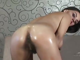 Sexy Arab women bends over to spreads dense hairy asshole
