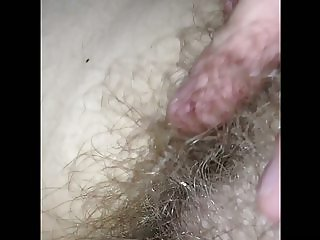 rubbing her natural hairy pussy,