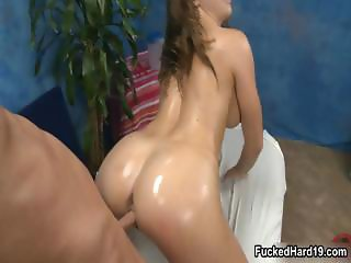 Oiled up brunette babe gets fucked part1