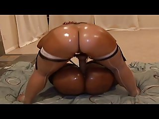 Sexy ebony whores get their asses oiled and ride dildo together