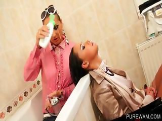 Cute lesbos playing in the bathtub