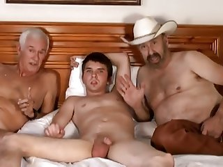 Cowboy, older man and young boy
