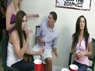 Students drinking tequila of girls tits