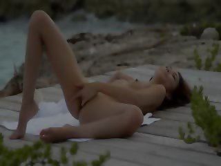 Asian angel masturbate by the ocean