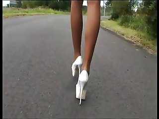 image Arteya street prostitute in miniskirt high heels boot and fishnet
