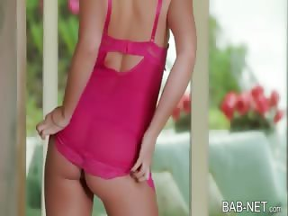 Horny blonde beauty rubs her pink pussy