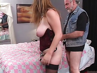 Sexy, thick brunette is bound and fucked on the bed by an older dude
