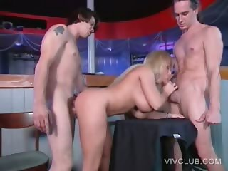 Big titted blonde takes two horny shafts