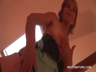 Mature blonde in stockings works her hot tits