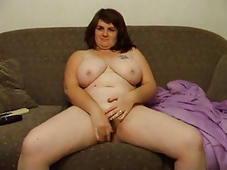 Joanne rubs pussy on couch