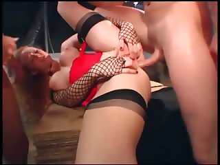 Sexy redhead in seamed stockings a garter belt and gloves gets dped