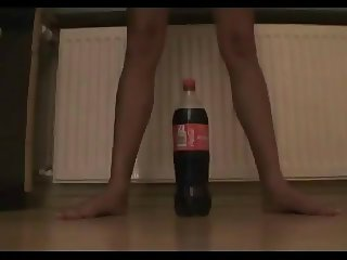 Tiny teen tries to ride a coke bottle