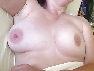 showing off and fondling wife's breasts after wake-up