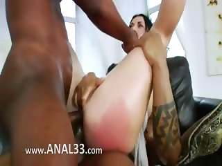 Two monster black penis in her anal