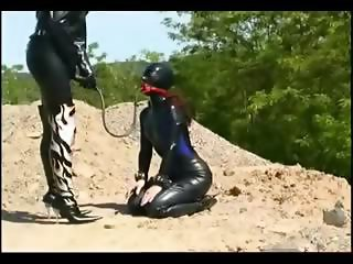 Domina taking care of her slave girl