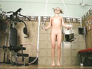 Blonde girl rides long dildo in the gym