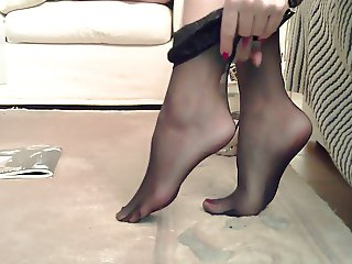 Sexy feet in black stockings