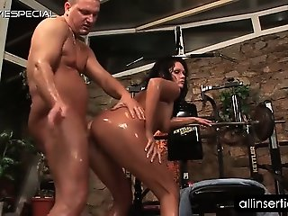Naked tramp gets her oily fuck holes deep dildoed