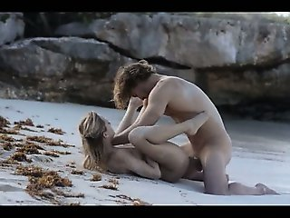 fine art sex of horny couple on beach