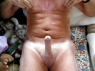 Grandpa plays with nipples then cums.