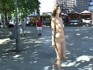 Naughty naked babe has fun on public streets