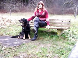 Tranny sitting on Parkbench near road