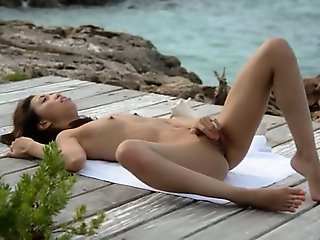 Asian angel stripping by the ocean