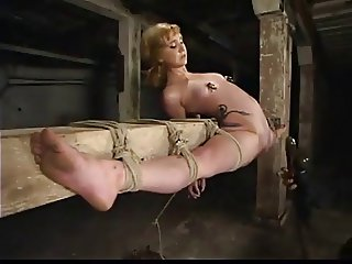 Blonde in overextended bondage