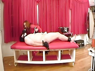BDSM dominatrix makes him wear a gas mask, restrains his balls, and fingers him