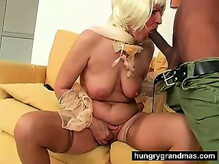 Horny grandma switches from toy to cock