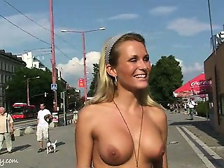 Crazy blonde chick has fun on public streets