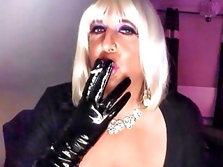 Chrissie smoking a 120 with black pvc gloves on