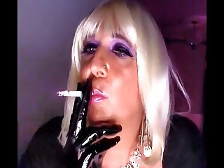 Chrissie smoking a Superking with black pvc gloves