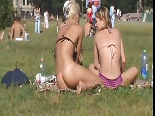 sexy blonde suntanning in a park