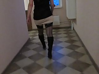 Walking in black stockings and leather boots