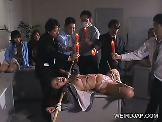 Jap sex slave punished with hot wax dripped on her body