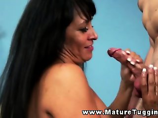Big boob milf mature tugging on dick