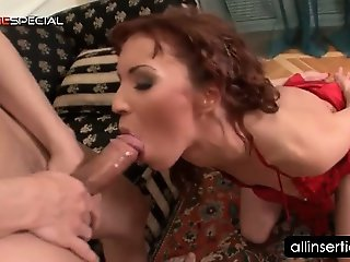 Slutty redhead gets twat fucked with double dildo