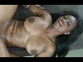 Ebony girl with big tits riding on a white cock