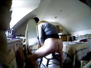 Mature woman playing with dildo